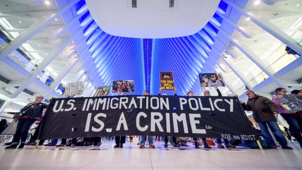 Banner that says US Immigration Policy is a crime
