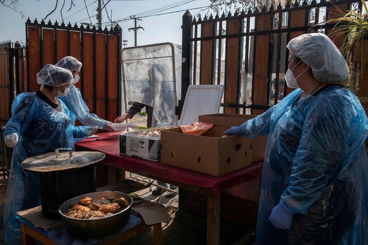 Workers preparing food in PPE